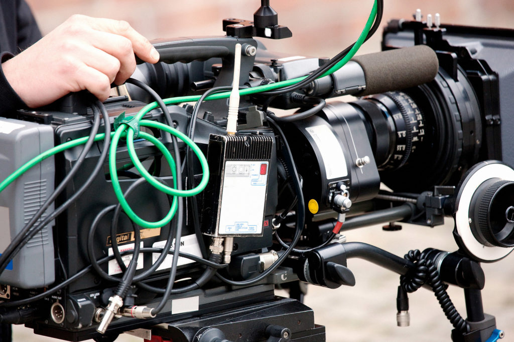 video camera in the hands of TV operator